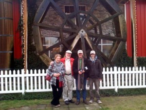 Linda, Bob, James and Fergus pose in front of the water wheel at the Mill Store.