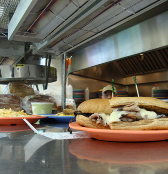 Our cook Bill is peeking over the Philly Cheese Melt. See him?