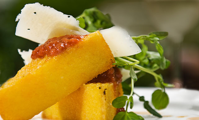 Letting polenta cool overnight in the fridge will yeild firm squares that are easy to grill or fry.