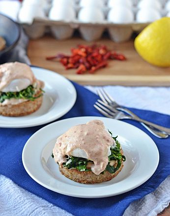 Arugula Eggs Benedict with Goat Cheese Sundried Tomato Sauce on Crispy Farina Cakes | Bob's Red Mill