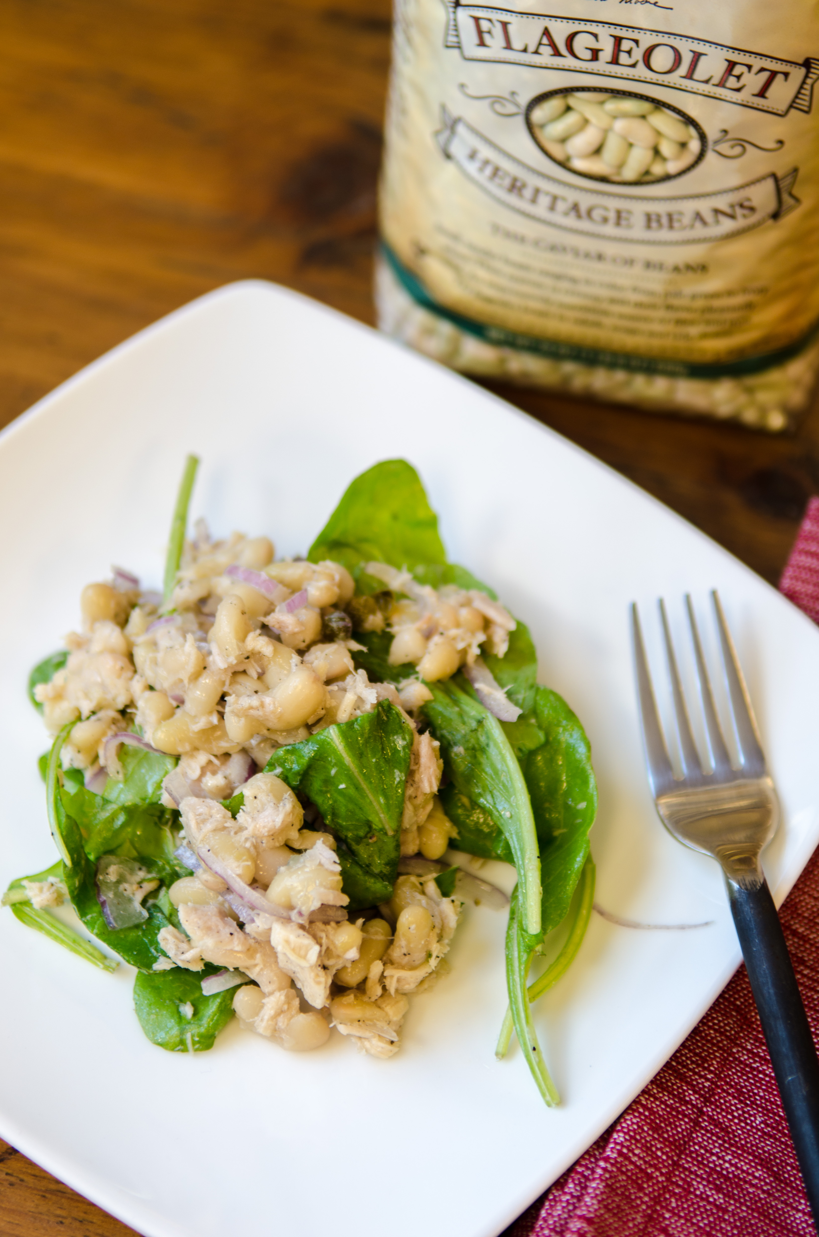 Flageolet & Tuna Salad : This light and refreshing flageolet salad uses oil, vinegar and capers for a zesty dressing that won't weigh you down with mayonnaise. These fresh flavors pair beautifully with creamy French flageolet beans, high-quality tuna fish and spicy arugula. This salad can be a main dish, a side or stuffed into a pita pocket for a twist on a tuna salad sandwich. // Bob's Red Mill