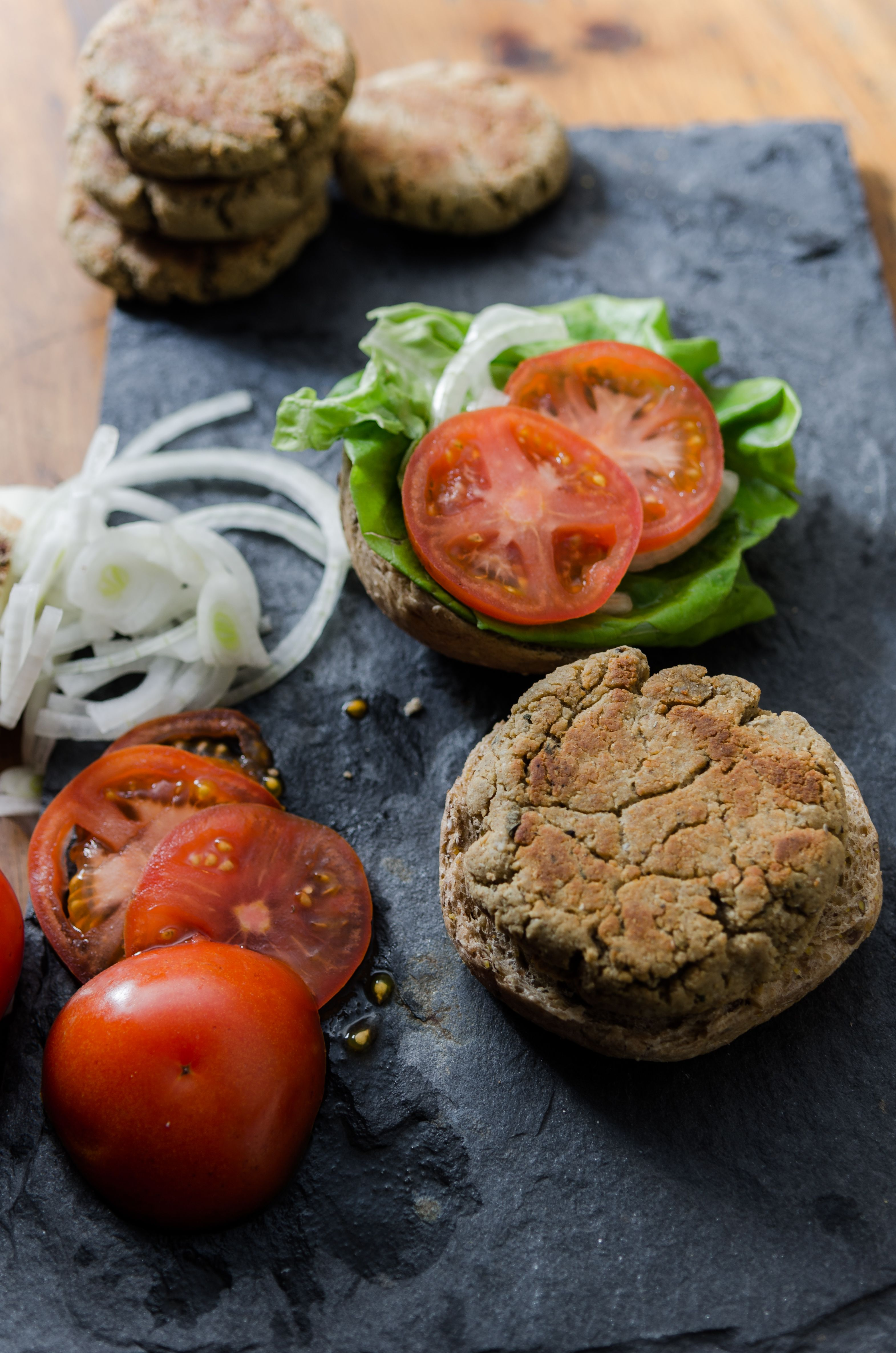 Hemp Veggie Burgers- tofu and hemp seeds make the base for a protein-packed burger that will knock the socks off boxed versions. // Bob's Red Mill // vegan, gluten free adaptable.