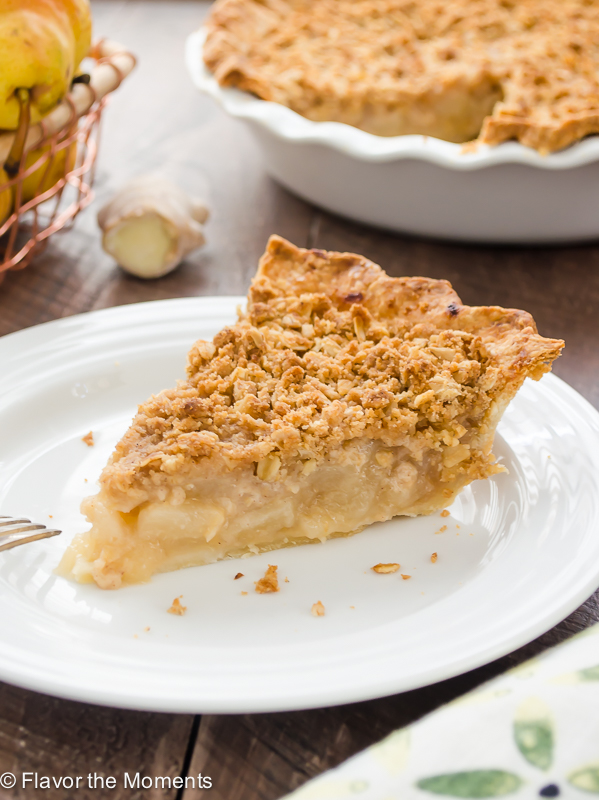 This pie is just what you need for the holidays. It's part pie, part crumble, with warm spices, juicy pears, and pop of ginger to help you celebrate fall the way it was intended. This Pear Ginger Crumble Pie would be a welcome addition to your Thanksgiving meal! // Flavor the Moments