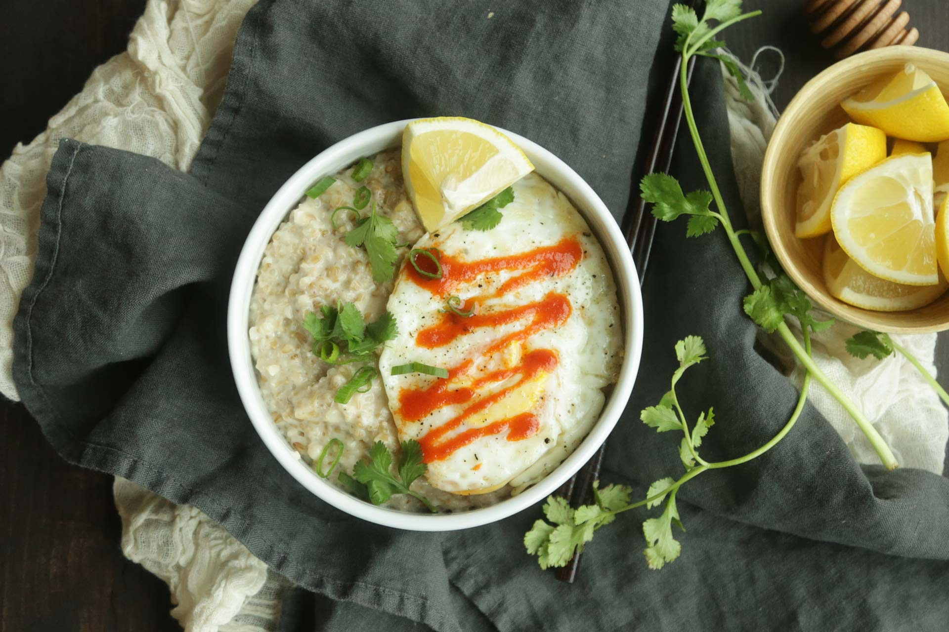 If you are looking to get out of the norm for breakfast and try something a little savory and spicy then this Asian Style Steel Cut Oats Recipe with a Fried Egg and Sriracha is your next stop.  It's easy to make, packed with flavor and loaded with nutrients, good carbs and protein to get you off on the right foot. // @BobsRedMill and @ChefBillyParisi